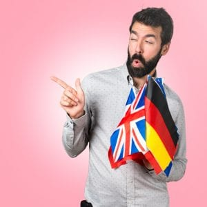 man winking holding international flags, accent