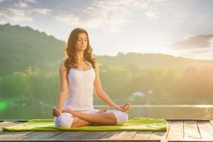 serene woman meditating and practicing yoga