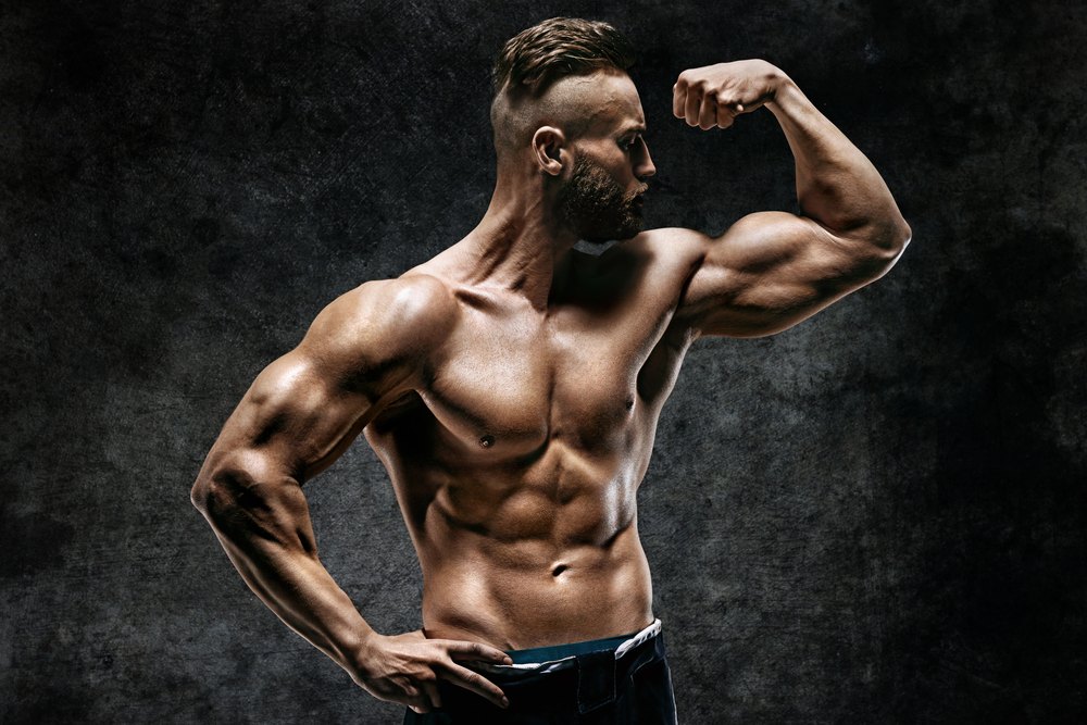 Progentra user with a sculpted muscular physique flexing bicep