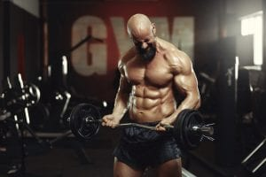 ripped man doing barbell bicep curls
