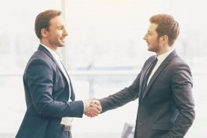 businessmen shaking hands and networking