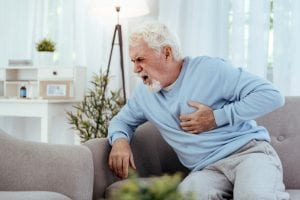 man having a stroke and heart attack