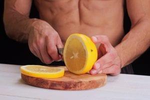 man cuts lemon