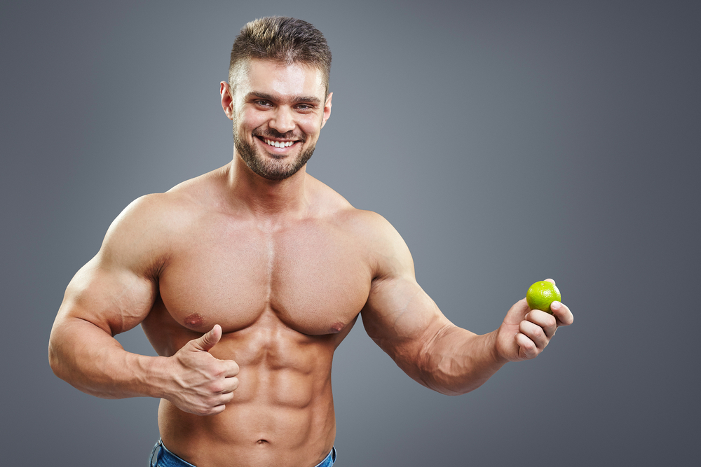 muscular guy holding a lime