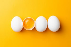 fresh eggs and cracked egg